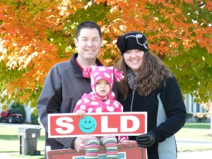Mark, Kylee and Mae with sold sign